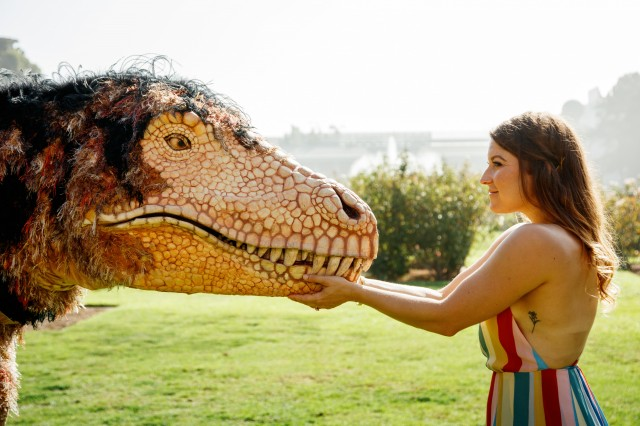 Hunter the T. rex puppet outside in Exposition Park's Rose Garden
