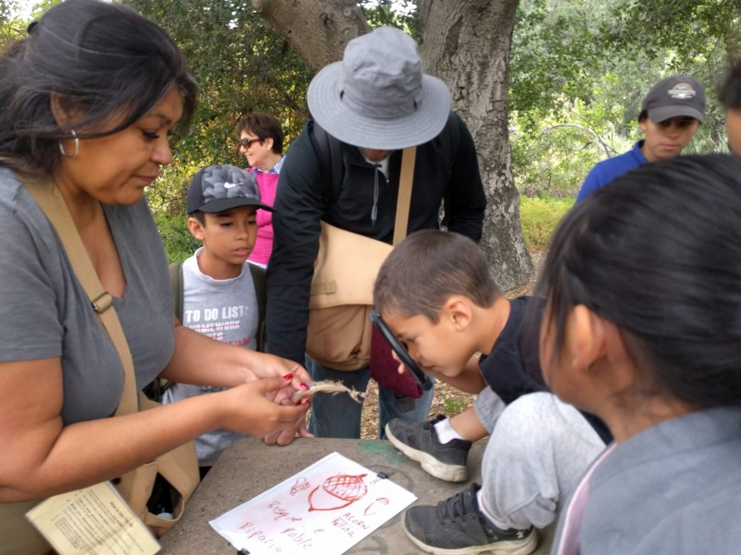 Brenda Kyle working with kids at a nature event.