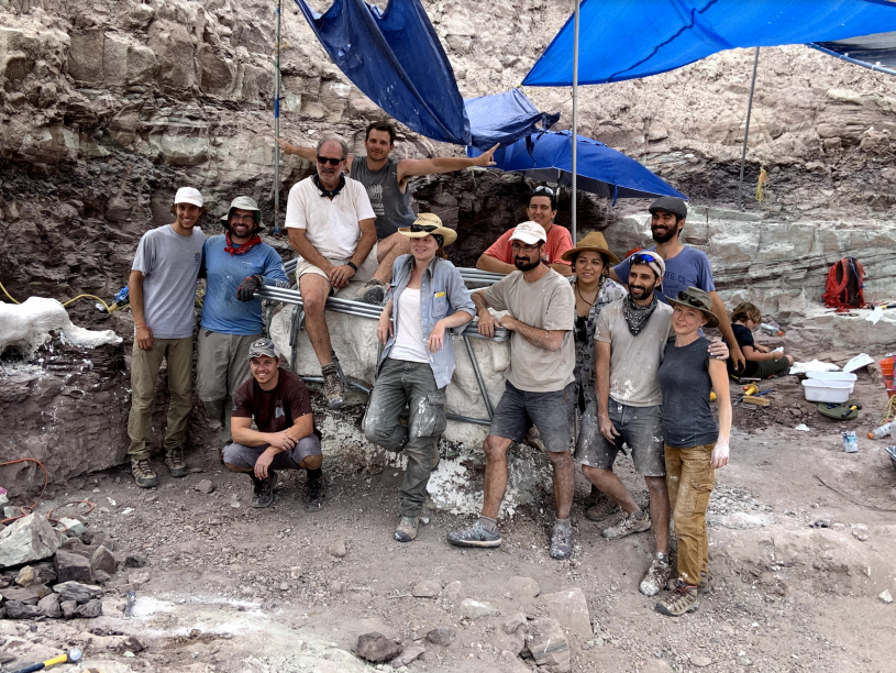 group of paleontologists smile pose for the camera
