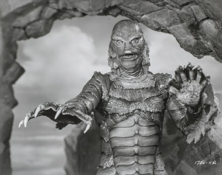 The fishy creature with arms outstretched, a still from the film The creature from the black lagoon.